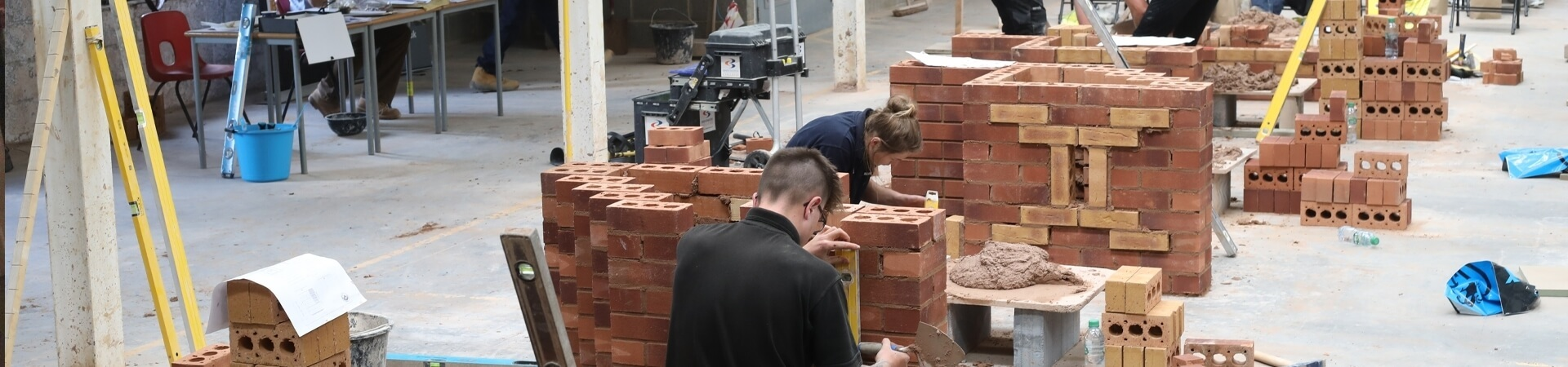 Students learning bricklaying